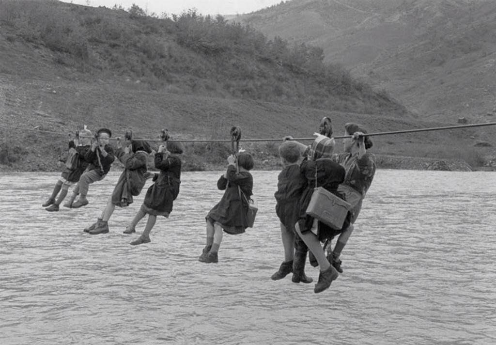 Children cross the river using pulleys on their way to school outside Modena, Italy   1959