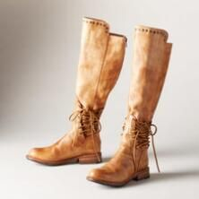 You'll love the chic accents adorning this luxurious pair of tall, brushed leather boots by BedStü.
