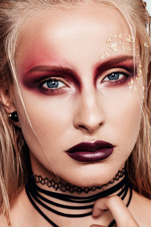 Dramatic makeup look with asymmetric burgundy smokey eyes ...