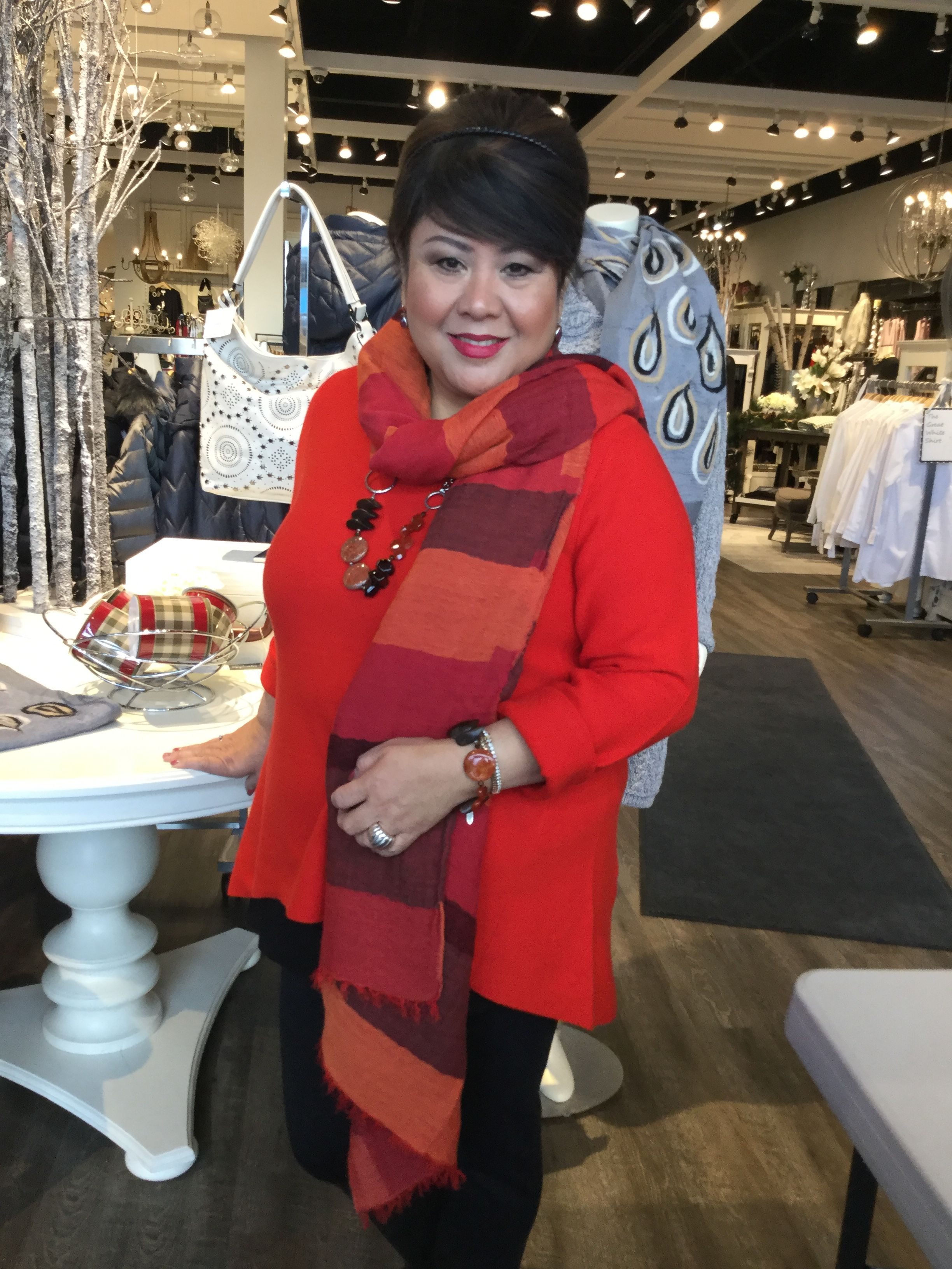 Pop of colour in this poppy red December look from Eileen Fisher.