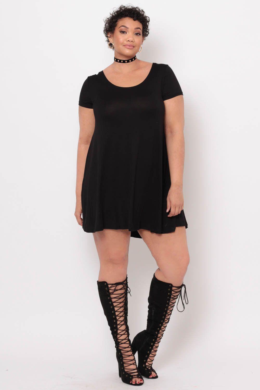 This plus size stretchknit tshirt dress features a round neckline
