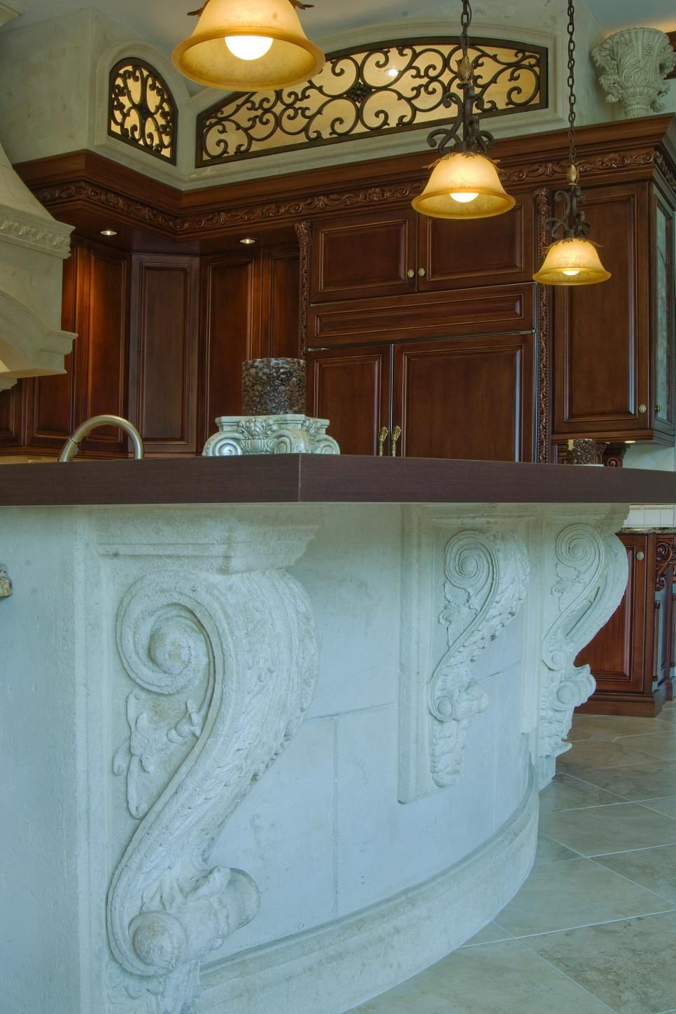 Ornate cast stone corbels support the spacious island in this ...