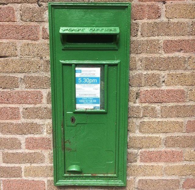 Irish post box outside templelogue college Dublin