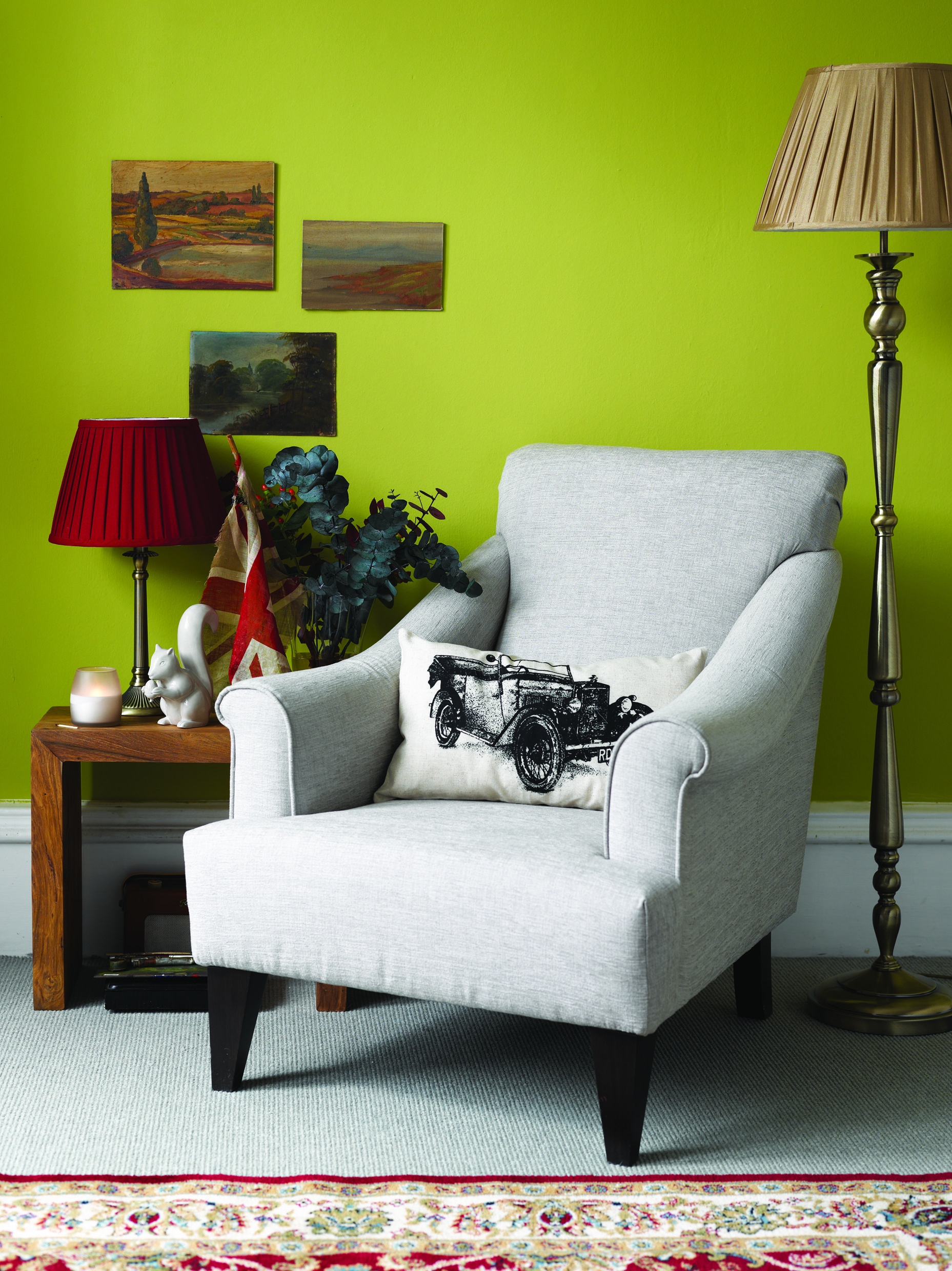 Lime Green Walls With Pleated Lampshades And A Squirrel Sculpture