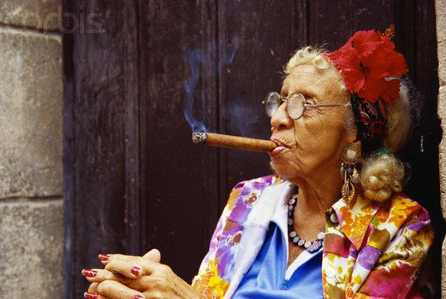 Elderly Cuban Woman Smoking Cigar By Dave G. Houser