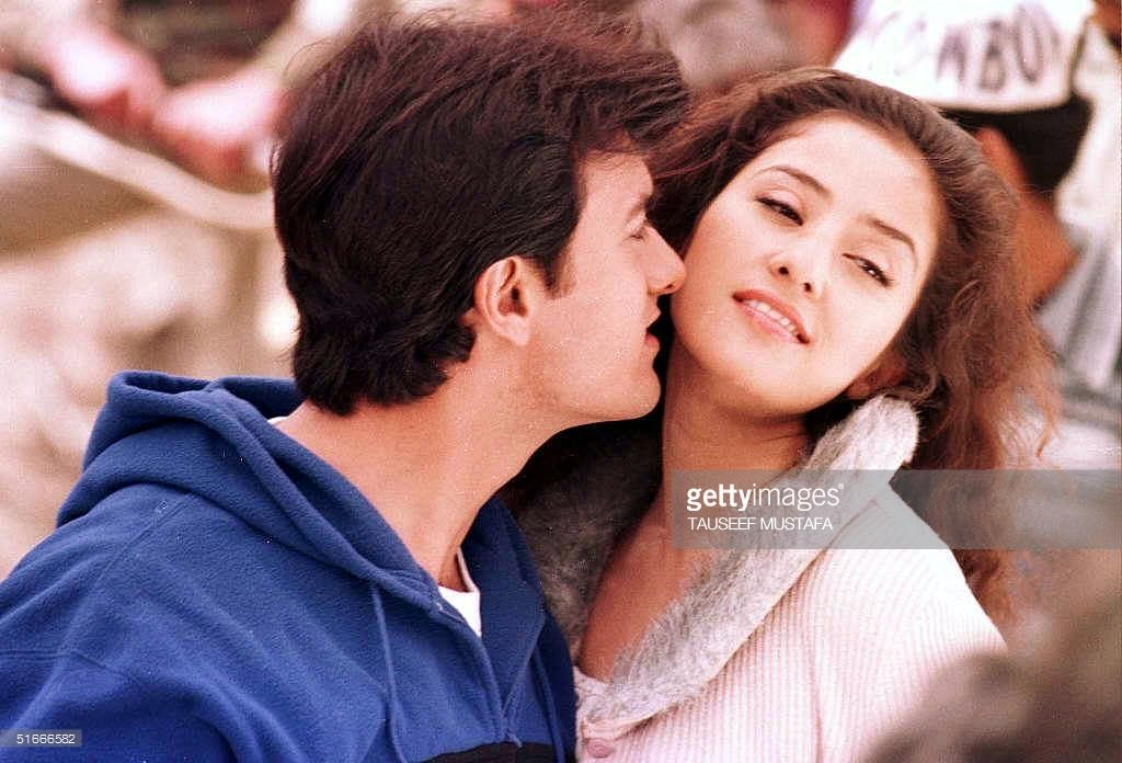 Indian Actor Amir Khan Kisses Actress Monisha Querrilla During The