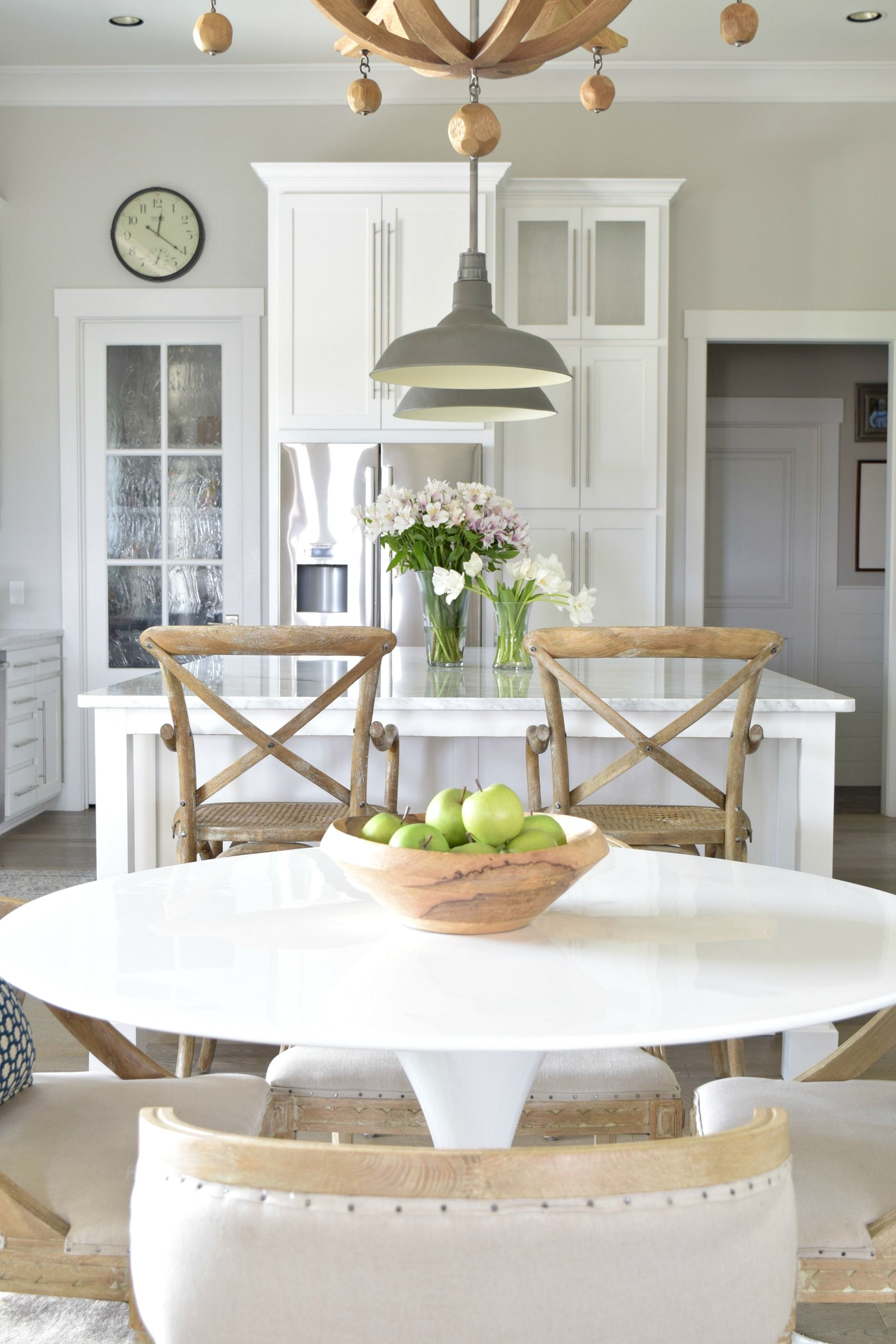 White Kitchen With Rustic Wood Furniture Accents Tulip Table
