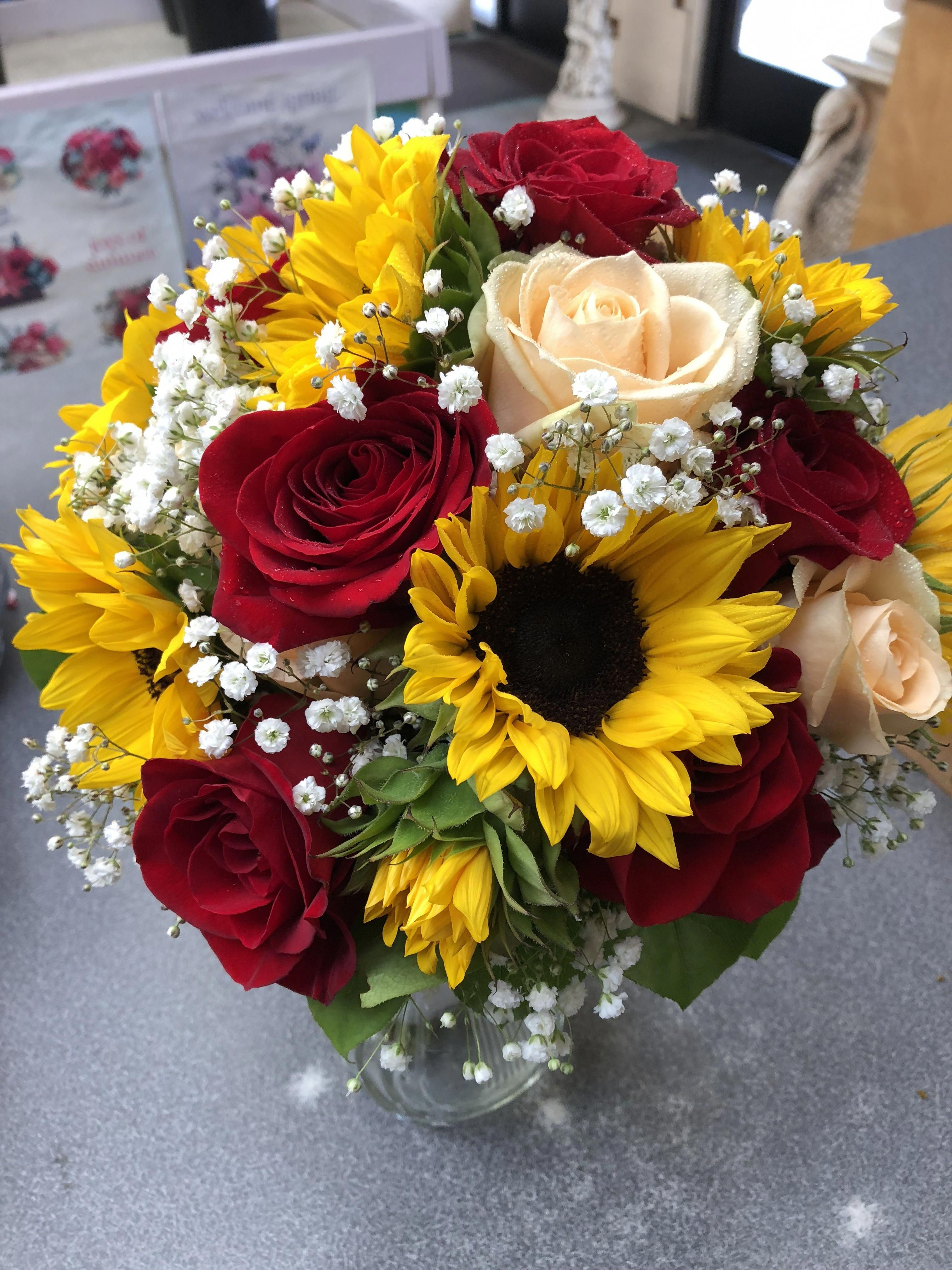 Daisy's wedding bouquet... Red roses, Sunflowers and