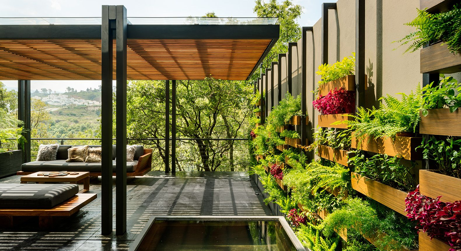 This Mexico City home is built around a gorgeous vertical garden    is part of Vertical garden City - The verdant Villa Jardín in Mexico City uses vegetation to unify its indoor and outdoor spaces