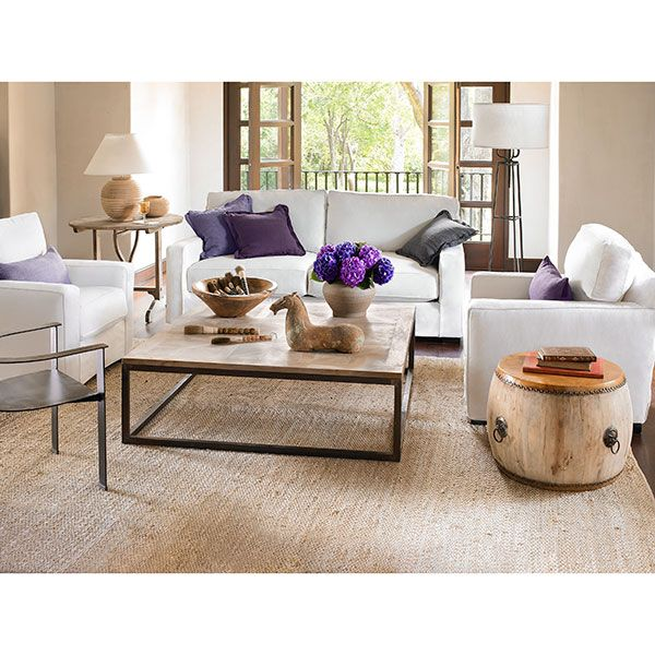 Super cute! All the light and white furniture give this living room a peaceful aura.