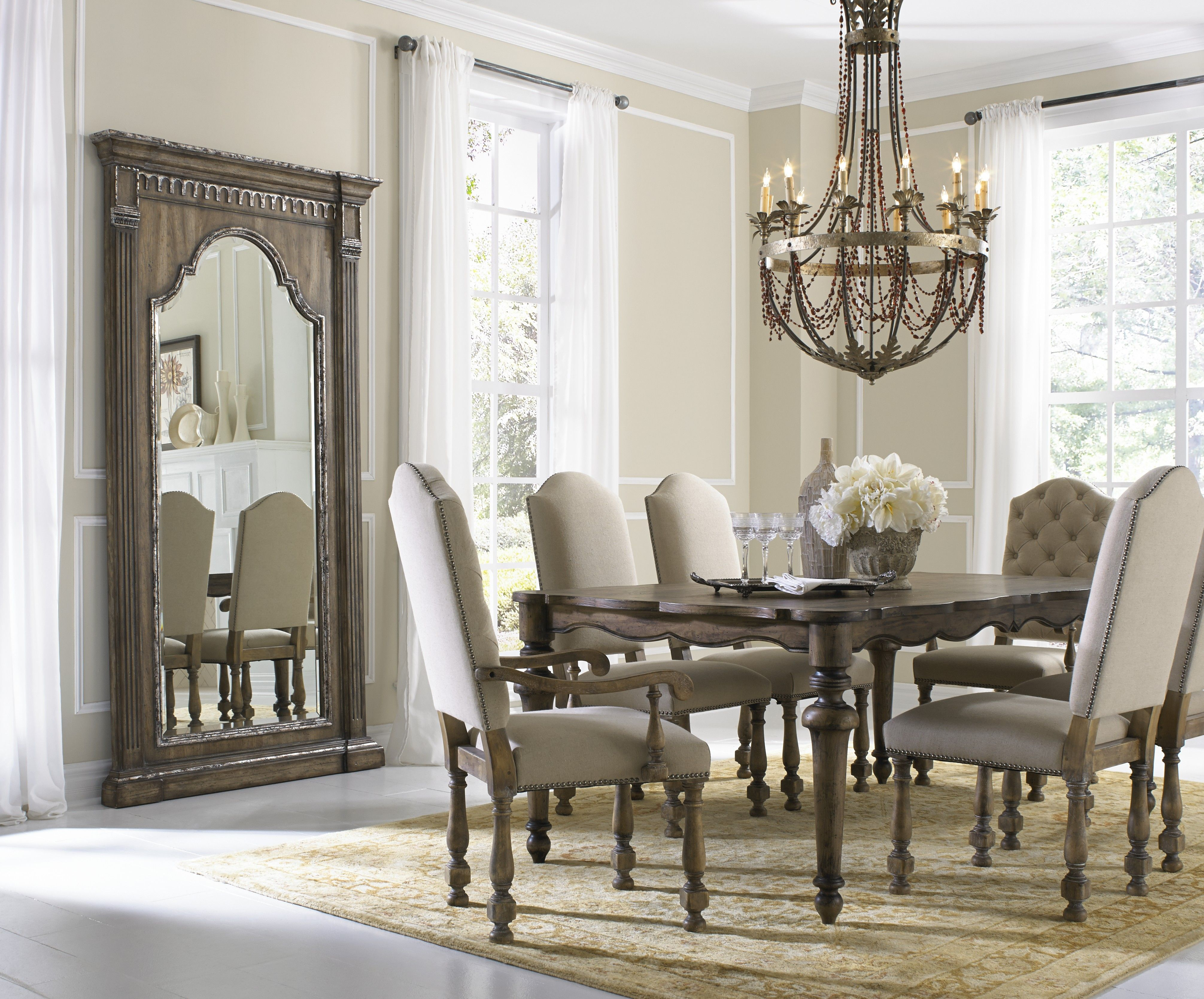 Rustic wood and off-white chairs give an elegant and homey ...