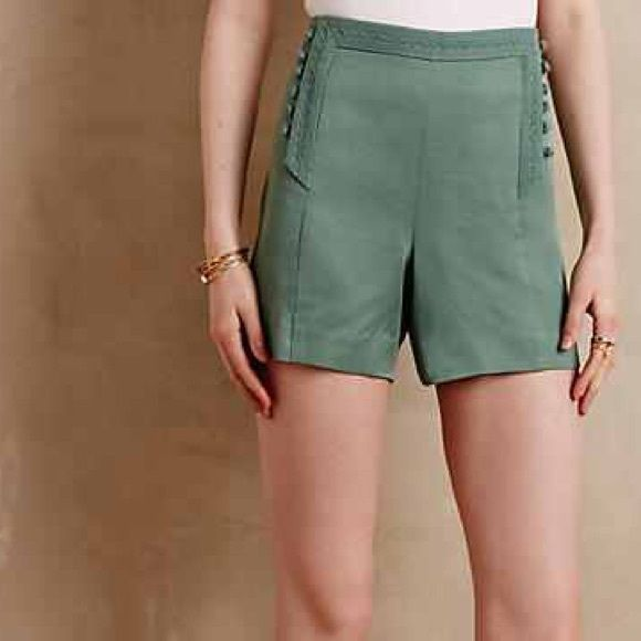 """Anthropologie Button Lined shorts Adorable green color. High waisted, 4"""" inseam. Tie bows on the side. From the brand Elevenses sold at anthro. Zipper on the side for easy on/off. Faux back pockets. Fabric is 100% Tencel, very soft. Anthropologie Shorts"""