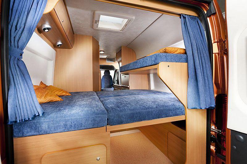 Sleeping area and storage Swan4 Camper Van