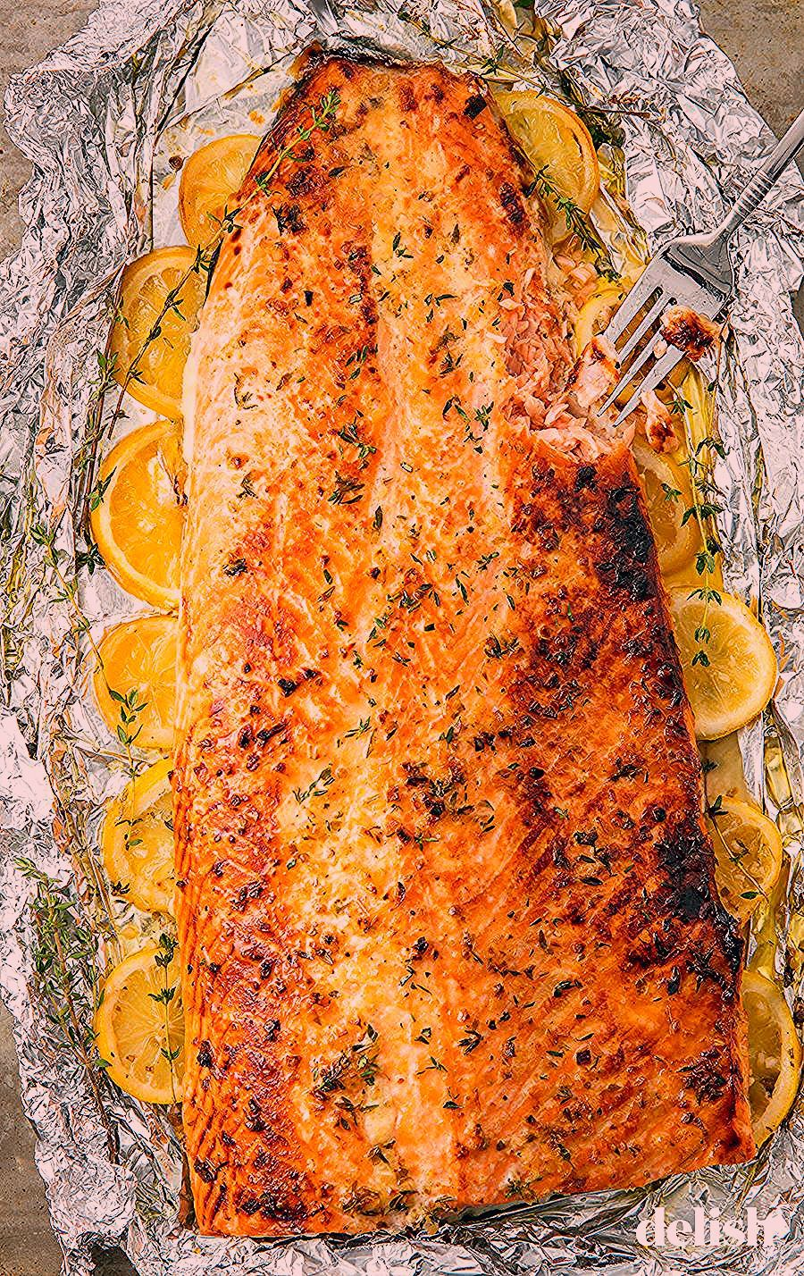 This healthy baked salmon in foil is the best way to feed a crowd. Get the recipe from .