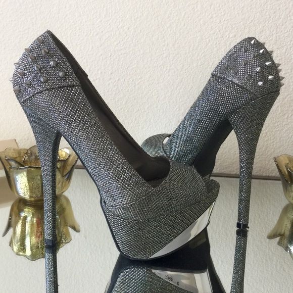 Sparkly Gunmetal High Heels with Spikes Beautiful sparkly gunmetal high heels with spikes on the heels. Beautiful shoes & pretty comfortable. About 6 inches high with platform. Worn a few times, but still in fabulous condition, there's a small area that's a bit fuzzy on the inside but it's not too noticeable (as seen in the last picture) Qupid Shoes Heels