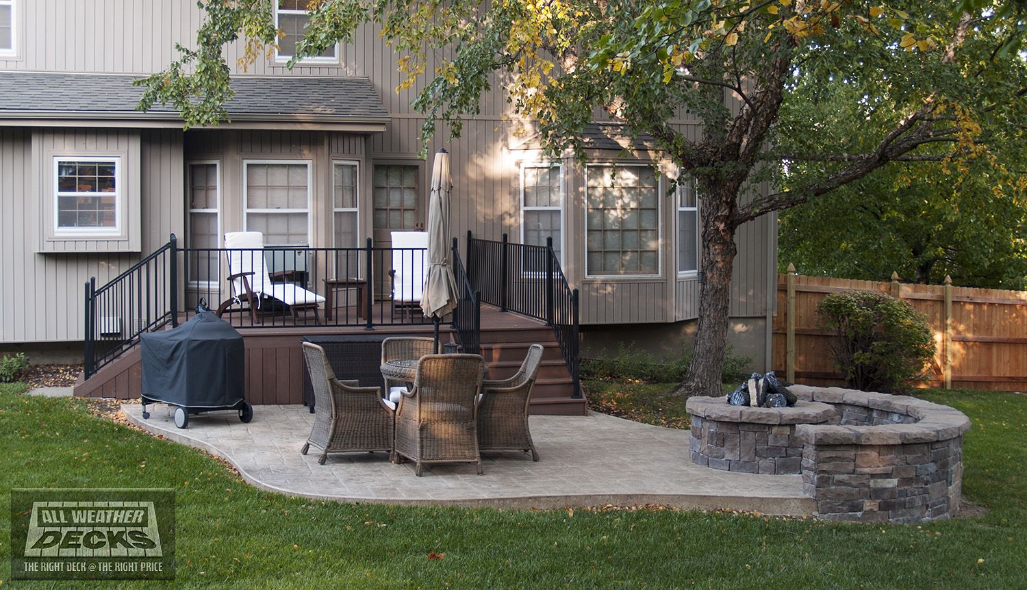 Azek (Morado) Deck With Fortress Steel Handrails, Solid Skirting, Stamped  Concrete Patio And Stone Wall And Fire Pit In Overland Park, KS