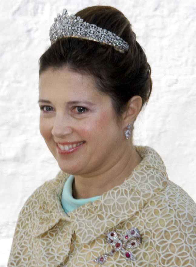 Queen Anne-Marie's Diamond Tiara.  Princess Alexia wears this small diamond floral tiara almost exclusively. The provenance on this is a bit unclear; some sources have suggested that the tiara is on loan to Alexia from her mother, Queen Anne-Marie, while others say that Alexia received the tiara as an eighteenth birthday gift from her parents.