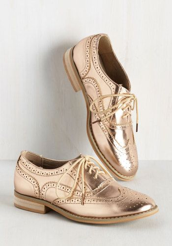 And now for your feature presentation - these metallic pink wingtips! Putting a flashy spin on the classic style, these thrilling, faux-leather kicks boast beige laces, sandy-colored soles, and tons of personality.