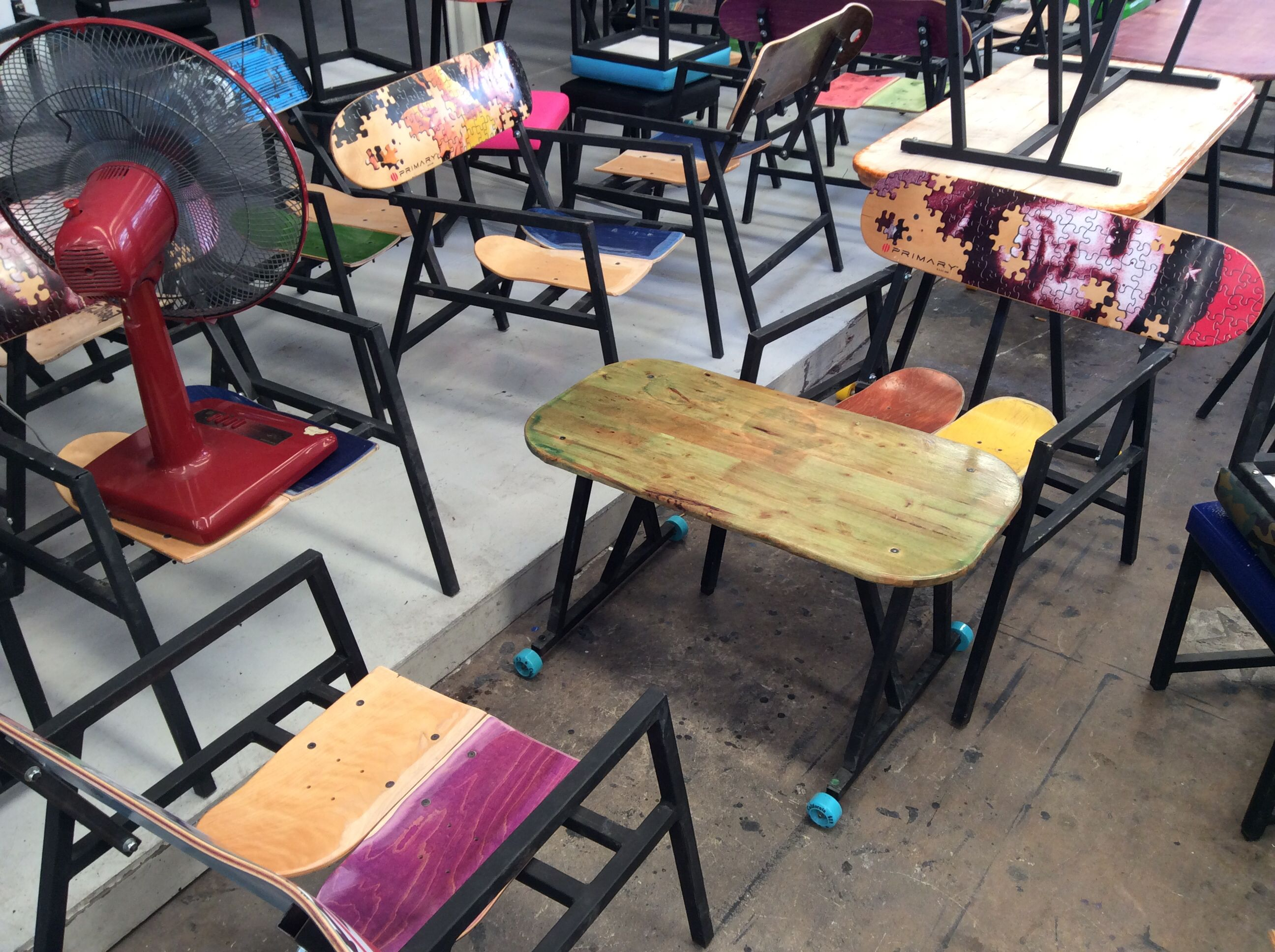 "Table on skateboard wheels at ""Skate Cafe and Bar Bangkok """