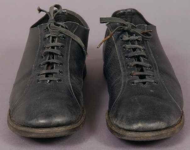 """Woman's black leather sport shoes, 1913-1918. The tongue is marked in pen """"B. Frederick, VZ, 6C."""" A similar pair is shown in the 'Ladies Home Journal', 1913. These shoes might have been worn with a Women's Service Corps uniform. Label: [stamped on sole] """"Essex Shed-Wet"""""""