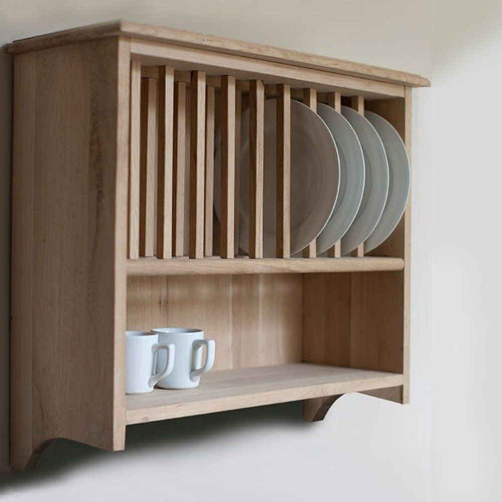 Rustic dining room with wooden wall mounted plate rack brown oak