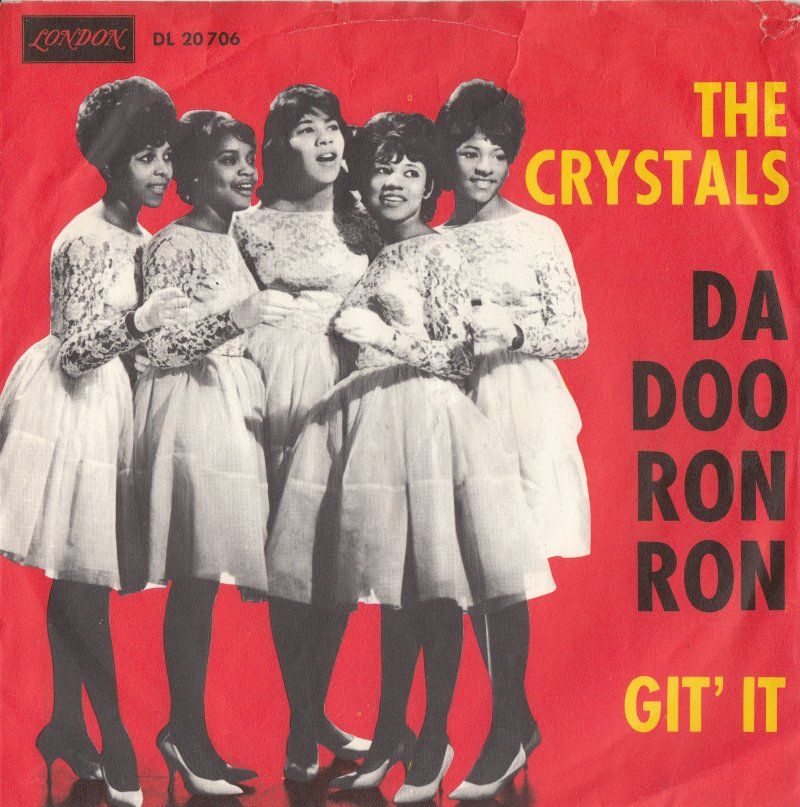 """""""Da Doo Ron Ron"""" is a 1963 single by American vocal group The Crystals, produced by Phil Spector in his Wall of Sound style. The song was written by Jeff Barry, Ellie Greenwich and Spector. The drummer was Hal Blaine. """"That's gold. That's solid gold coming out of that speaker."""" said Spector after listening to the final playback of """"Da Doo Ron Ron"""". The single peaked at #3 in the US and #5 in the UK. In 2004, this song was ranked #114 on Rolling Stone's list of The 500 Greatest Songs of All…"""