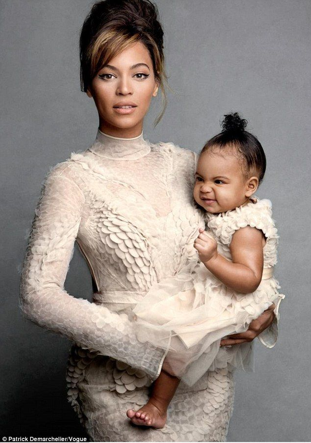 Cute recap: Beyoncé took to Instagram to share images from her 2013 shoot for Vogue on what she called 'Flashback Friday' including this one of her with'the real cover girl. My delicious Blue Blue at 11 months'
