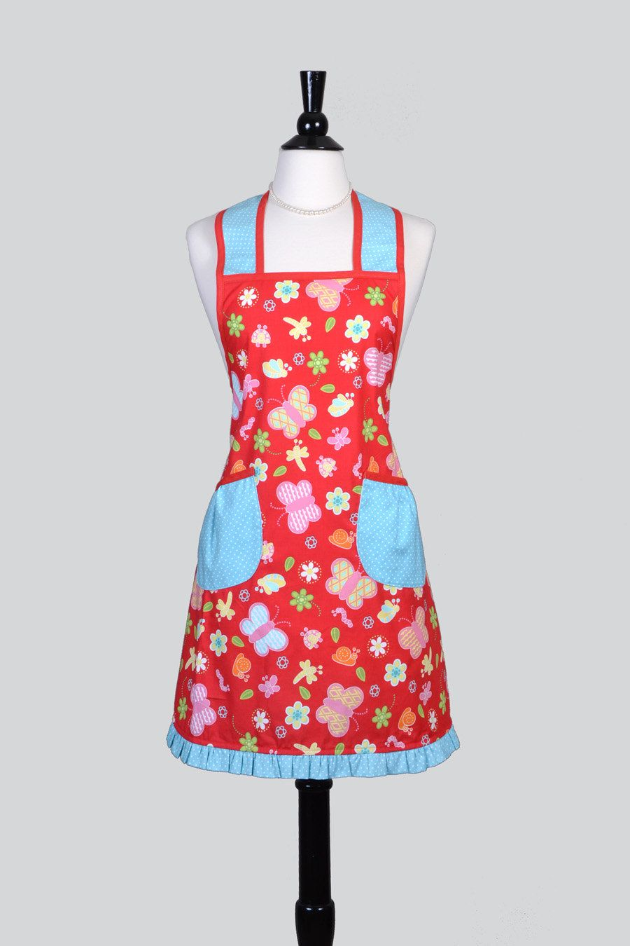 women's retro apron features red and aqua fabric with butterflies