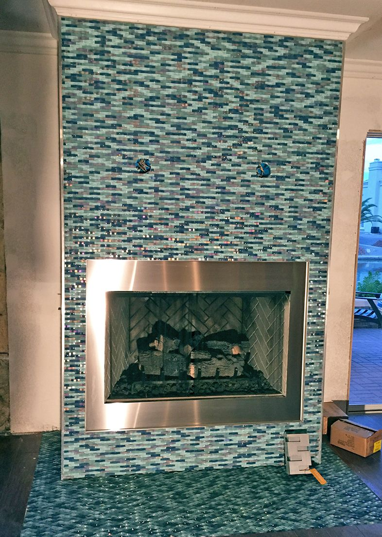 Ripple Stream Blue Curved Tile Is Stunning On This Fireplace In Nevada Hues Of Blue And Hints Of Iridescen In 2020 Iridescent Glass Tiles Pool Tile Glass Mosaic Tiles