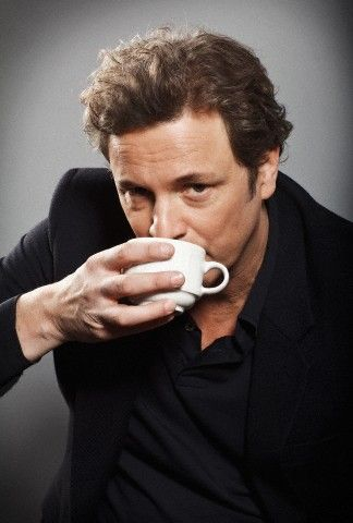 Colin Firth (he's much more handsome than this photo makes him look!) drinking tea.