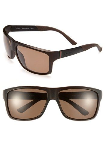 8f35165872 Sporty wraparound frames define lightweight sunglasses fitted with ...