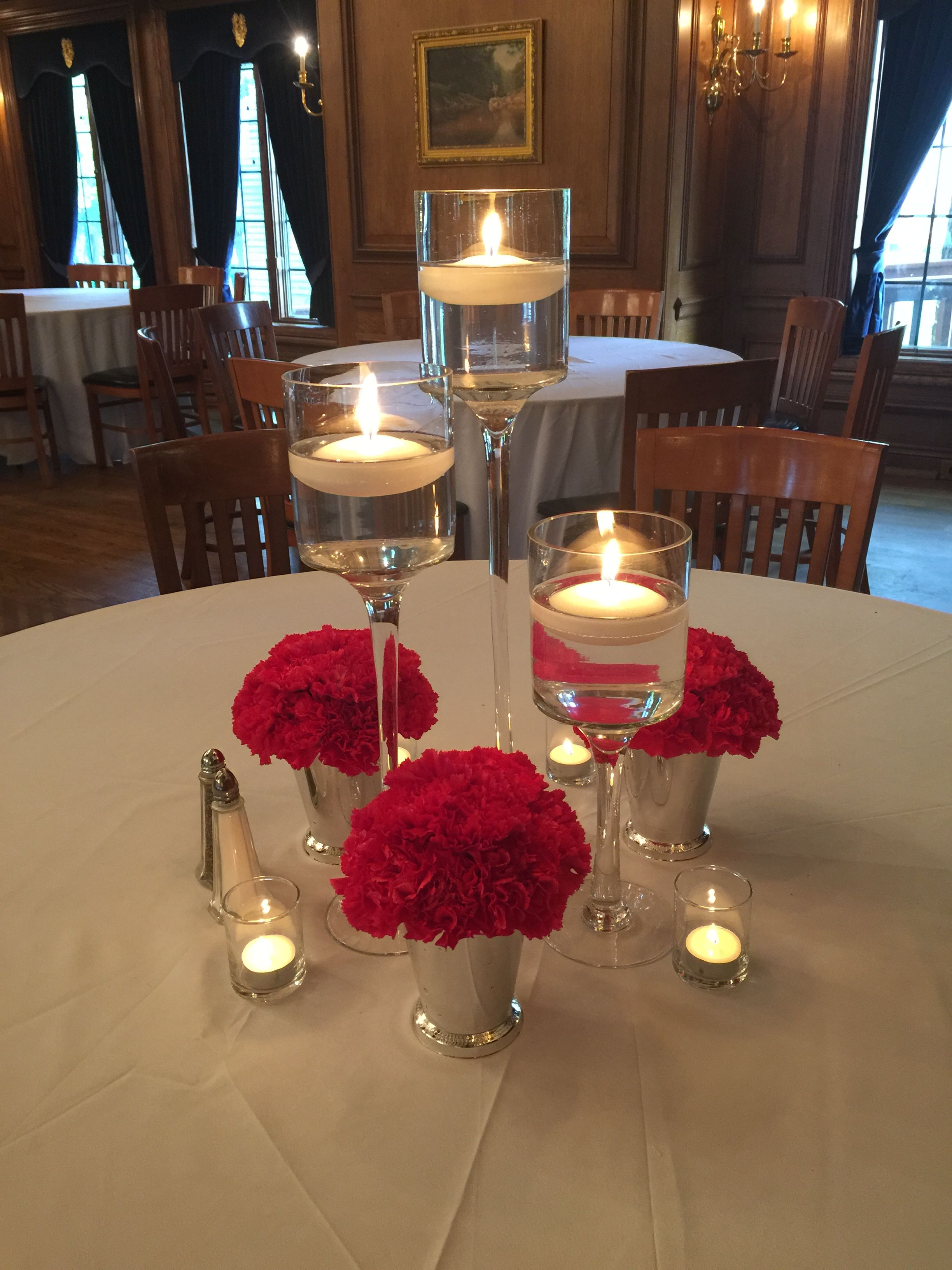 Centerpieces by flowers of the forest tall stemmed