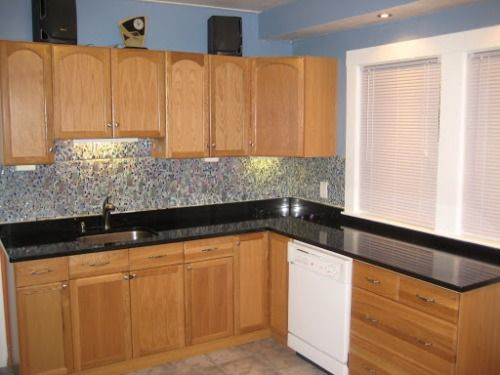 Oak kitchen cabinets with black granite countertops home for Kitchens with dark counters