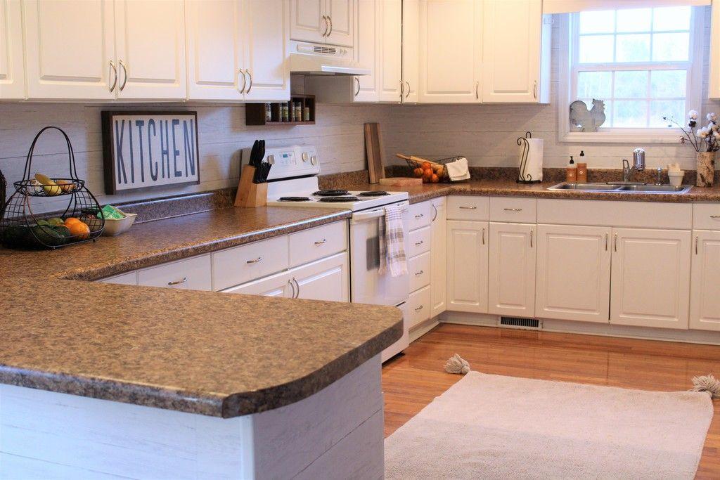 Shiplap Peel And Stick Wallpaper Used As A Kitchen Backsplash Kitchen Backsplash Tile Designs Backsplash Wallpaper Kitchen
