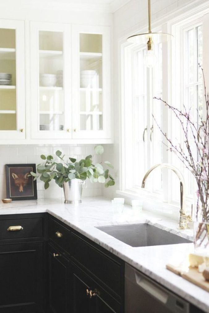 Beautiful Cottage Kitchen Design Remodel.  Black lower Cabinets with white upper cabinets and marble counter tops.  Gold cabinet pulls, faucet and gold fixtures. #PinkPeppermintDesign #interiordesign #cottagekitchen  #homeremodel