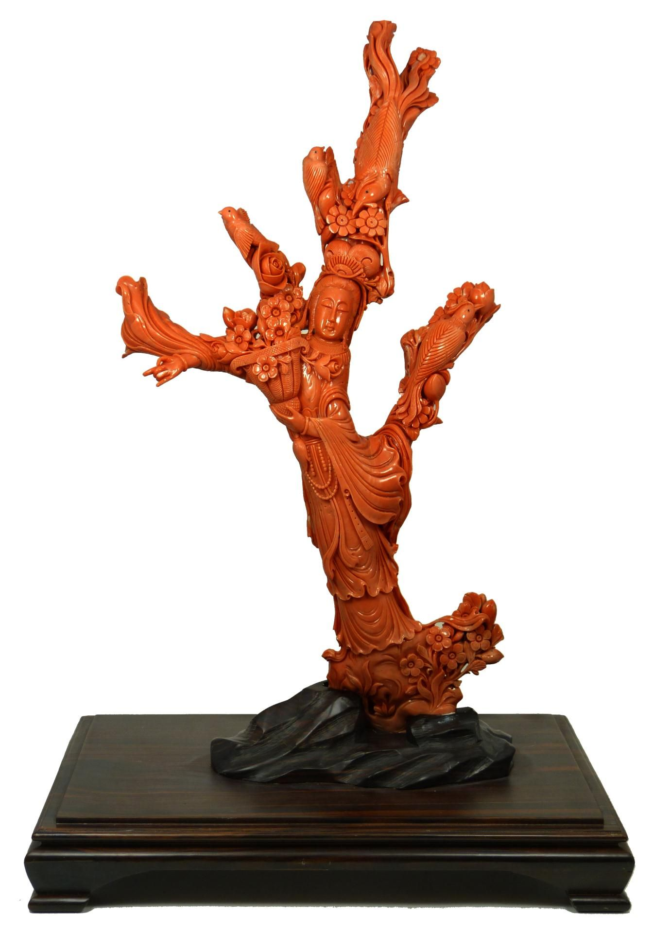 "CHINESE RED CORAL CARVING OF QUAN YIN Massive hand carved Chinese Red Coral figure depicting Guan Yin with four birds. Finely carved throughout with stunning detail with relief carving throughout. Includes fitted wooden display stand. Measures 19"" height x 10"" width"