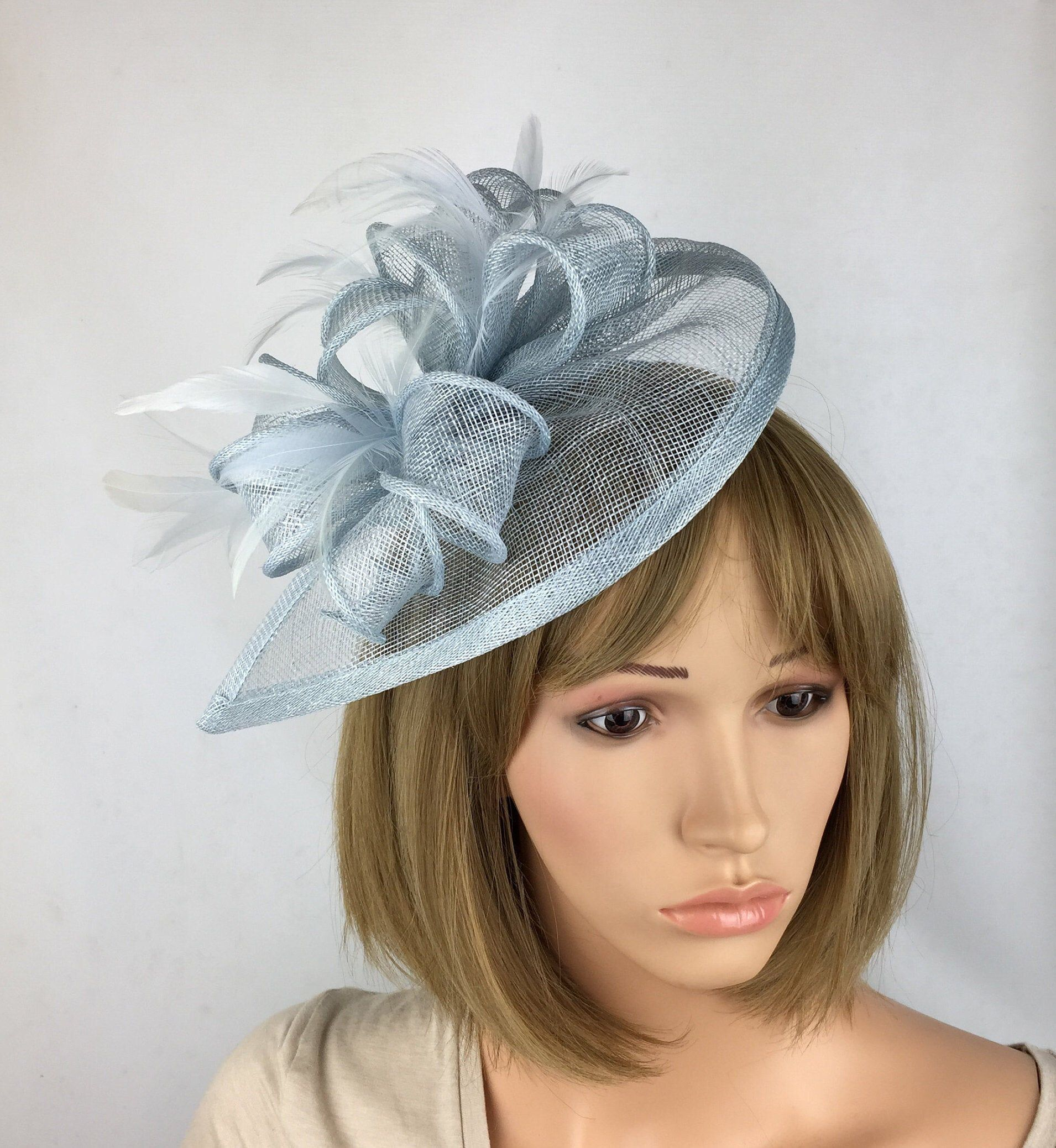Pale Blue Fascinator Pastel Blue Baby Blue Fascinator Hatinator Teardrop Wedding Hat Mother of the Bride Ladies Day & Ascot races occasion H #fascinatorstyles • Perfect Pale Blue hair fascinator for any outfit, for a wedding, mother of the bride or guest, a day at the races, a tea party, bbq, dinner dance or a memorable occasion, garden parties, hen night, etc • Striking hat and bow fascinator complemented by beautiful feathers on a curved teardrop • This quality fascinator is mounted on a #fascinatorstyles