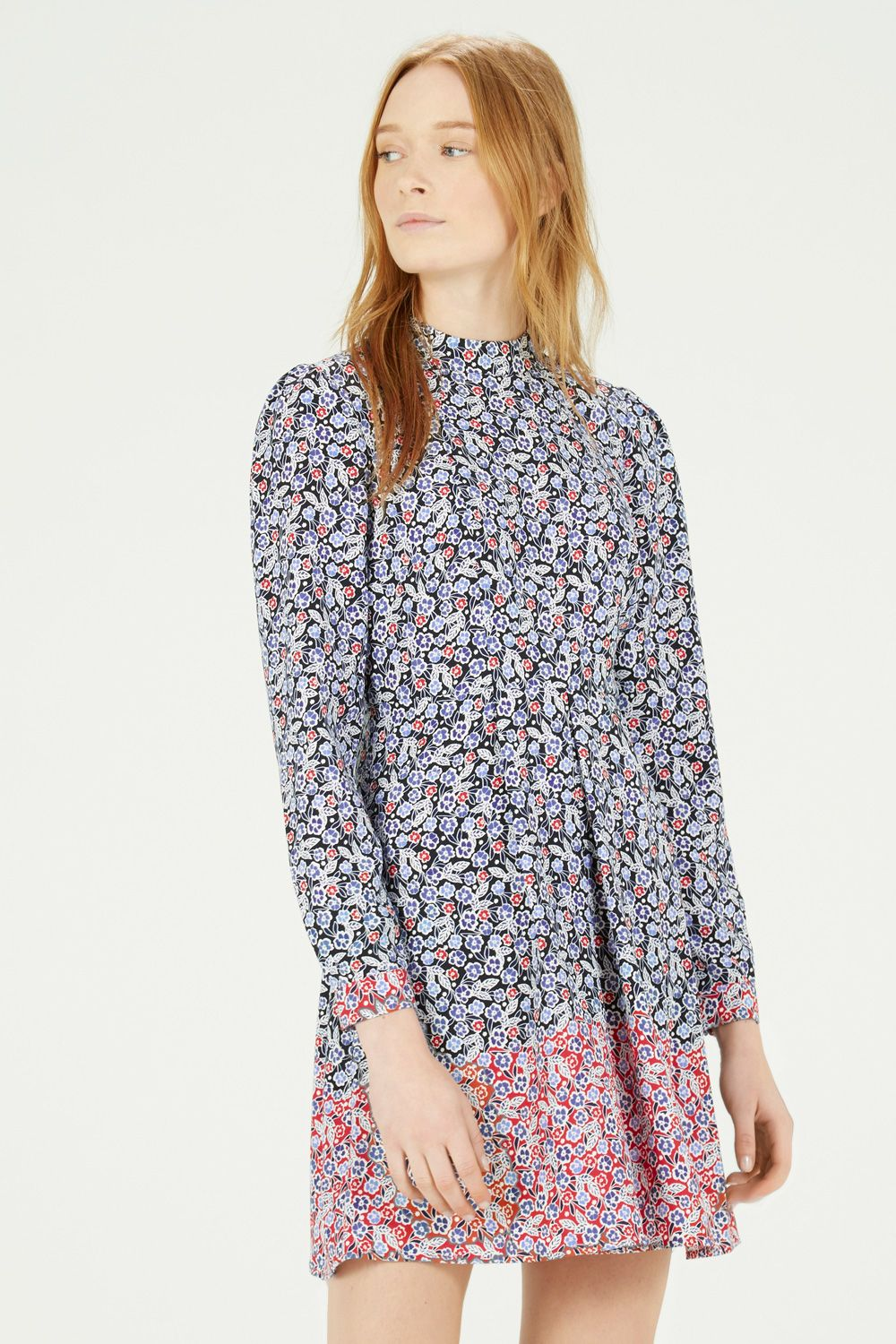 cdd3da67a26a This floral dress is constructed from a casual woven fabric and features a  high neck, puff shoulder detailing and a nipped in waist.