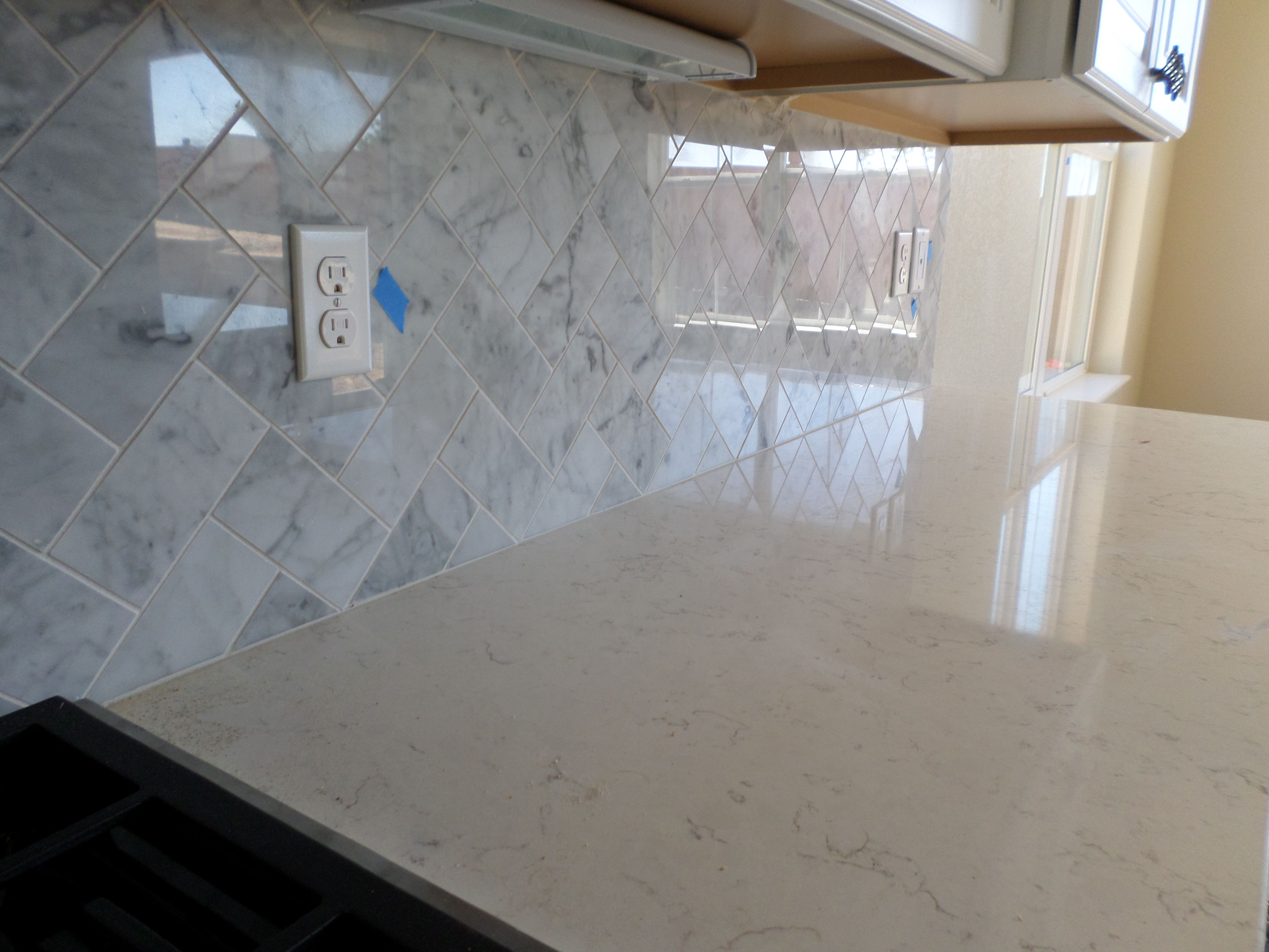 Emser Bianco Gioia Marble Herringbone Pattern Kitchen Backsplash