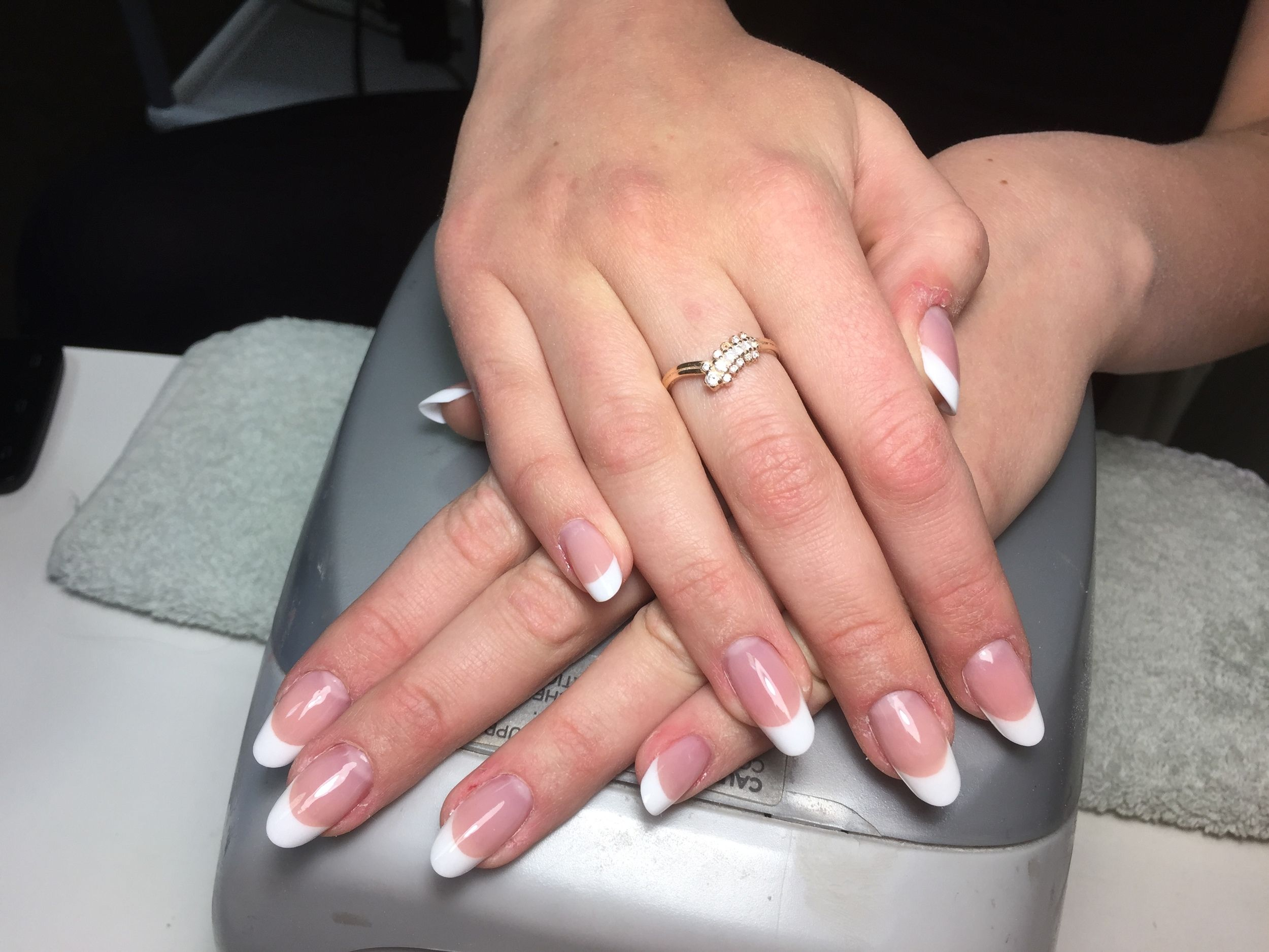 Sculpted acrylic nail extensions with french tips. Oval shape ...