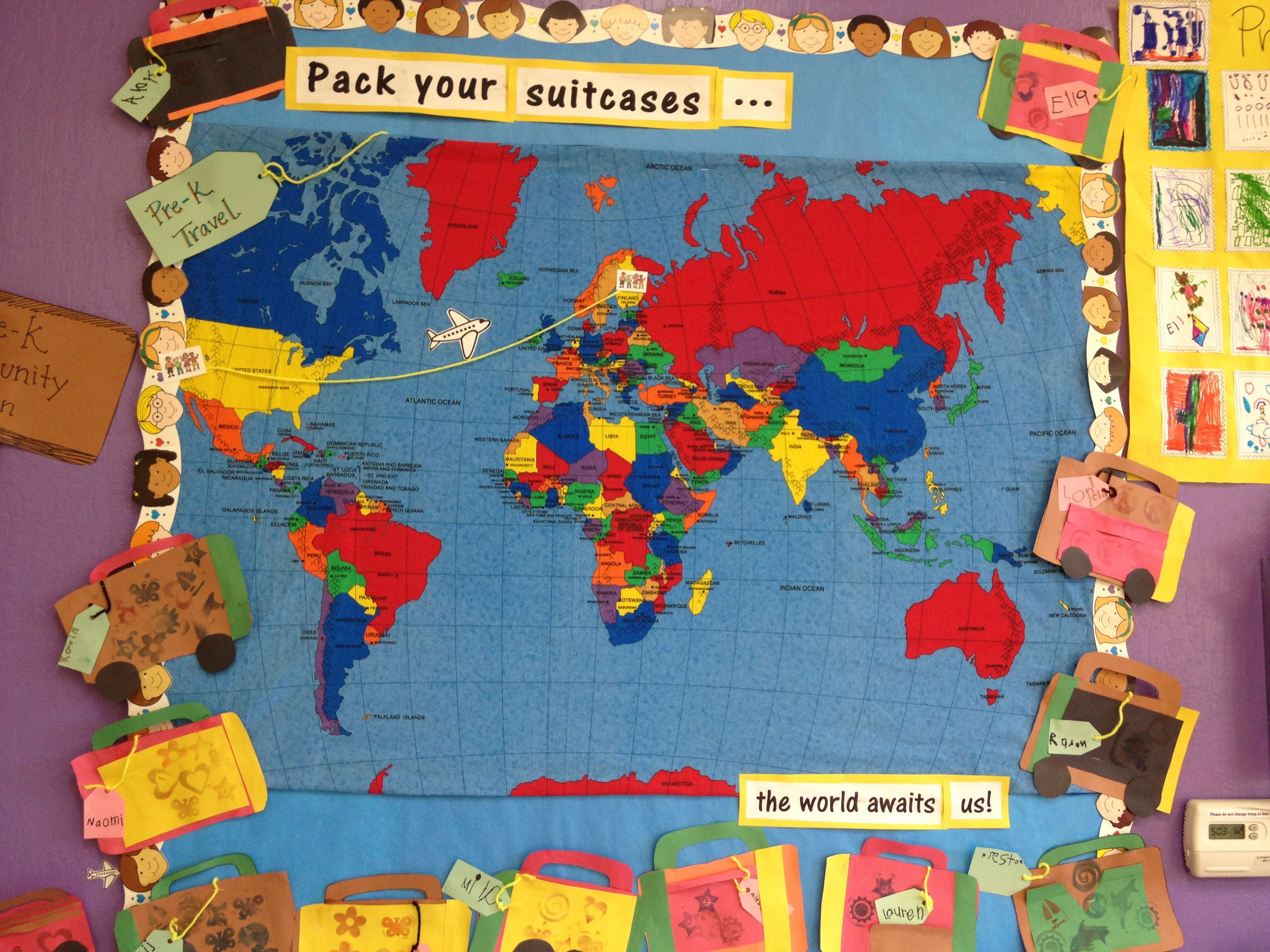 Learning About The World And Cultures Month Bulletin Board Pre K S Pretend Travel Around With Their Suitcases In Hand Map Tracker Of