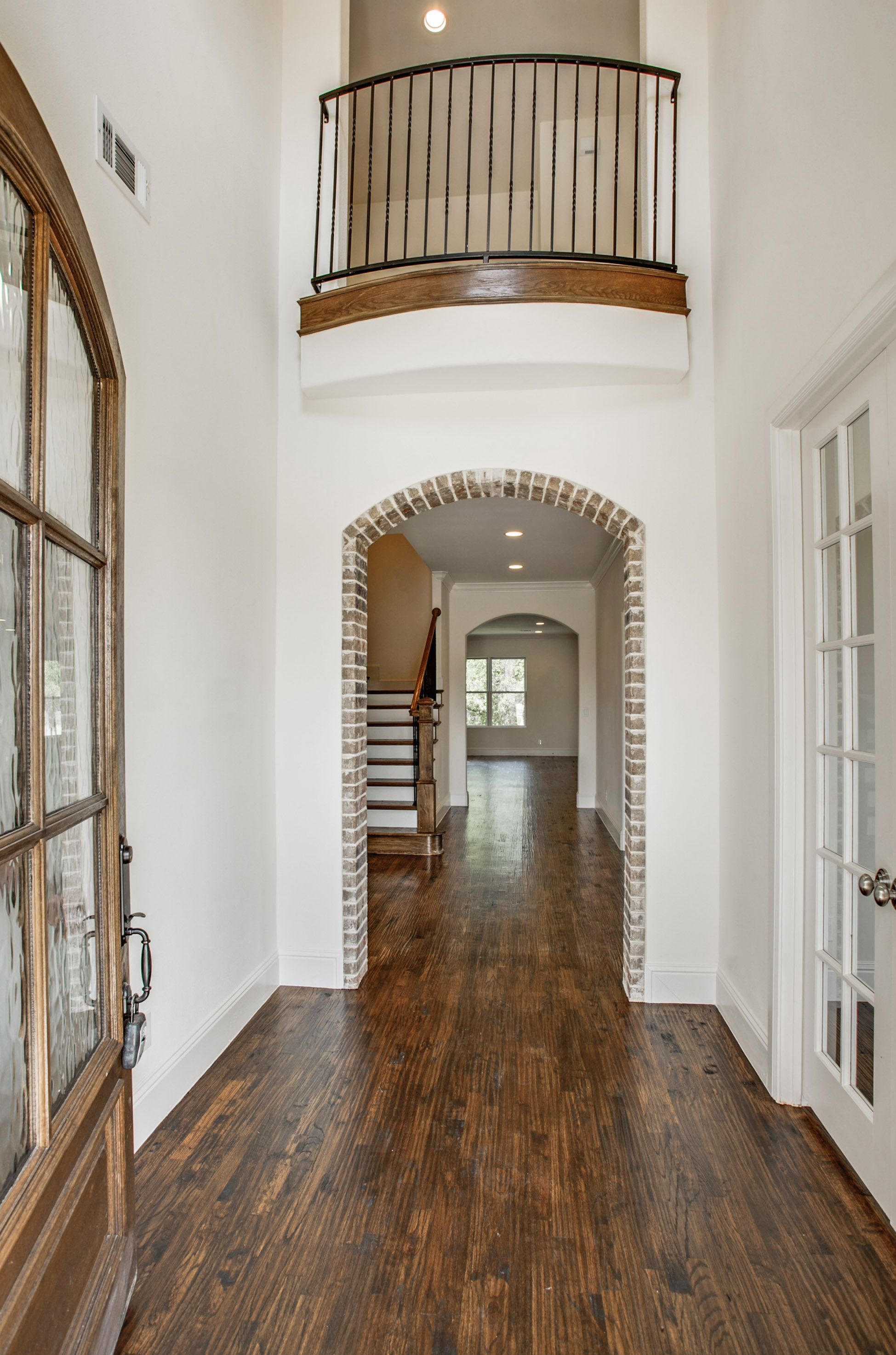 French-Style La Cantera Home. Exposed Brick Arch. Entry Archway. Two Story
