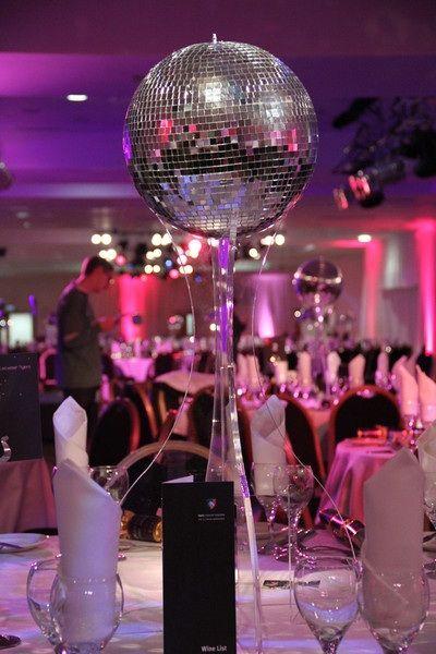Interesting way to elevate disco ball for centerpiece ideas american hustle party pinterest - Ideas para discotecas ...