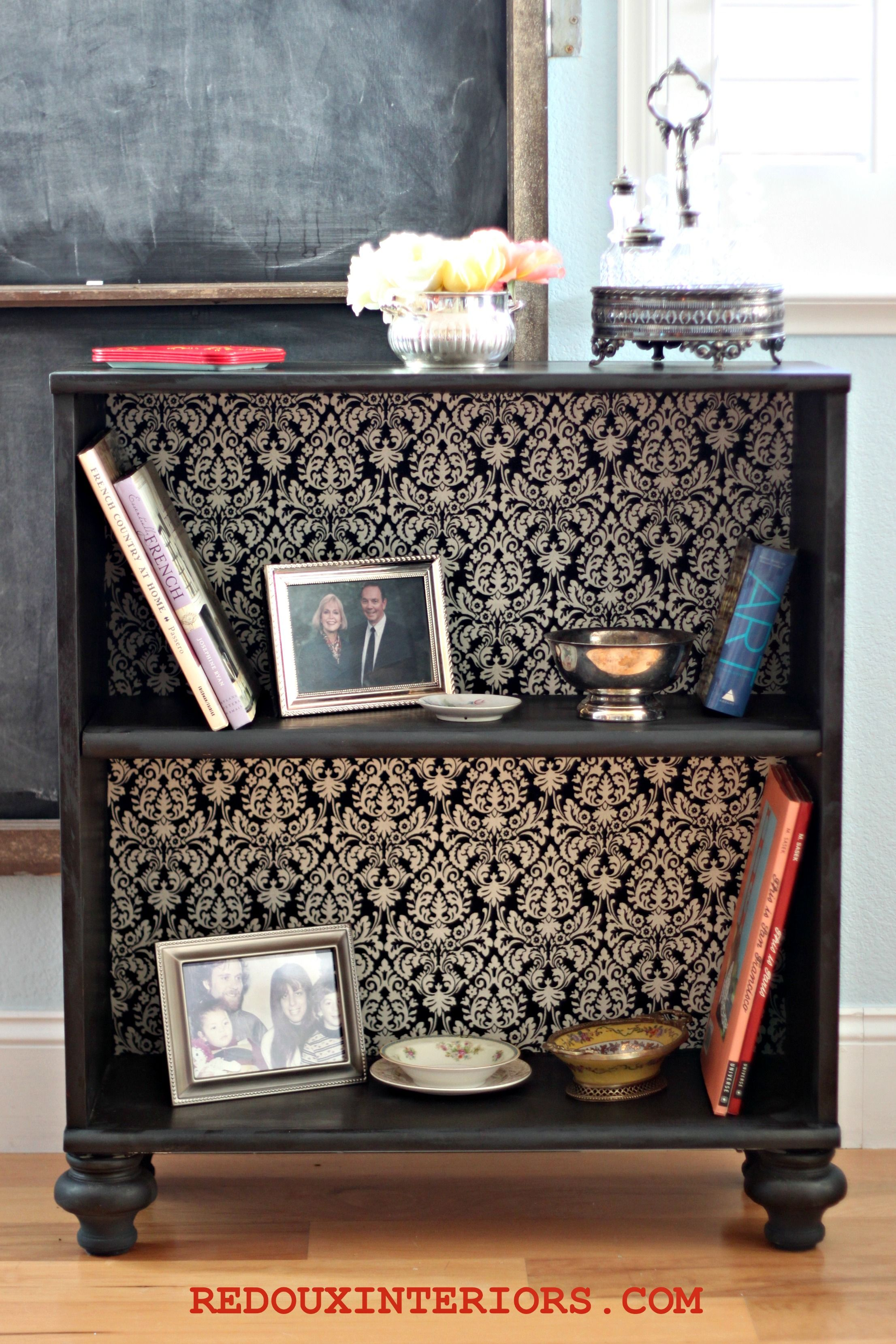 upgrade a plain bookshelf add feet and wallpaper or bead board