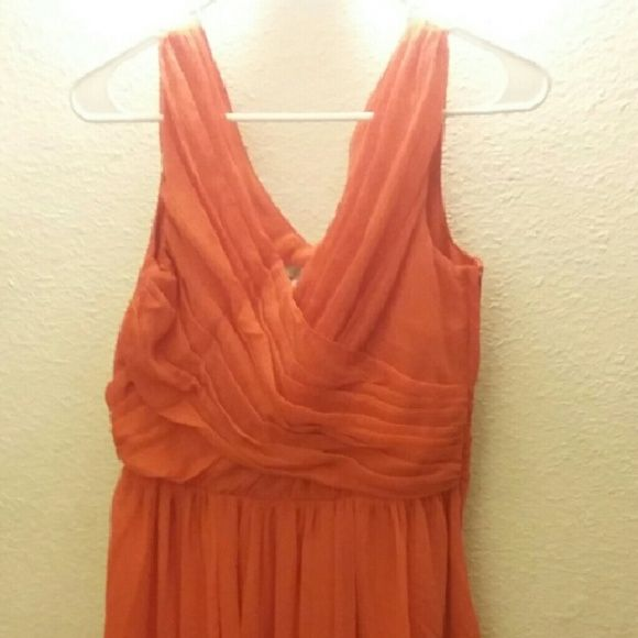 NEW ORANGE FORMAL DRESS FROM H&M New orange formal dress from H&M. This style from the bottom is relax and loose. Is a beautiful dress for either Easter Sunday, church or any wedding. Removed tag (I have it) but was going to wear but never did. H&M Dresses Maxi
