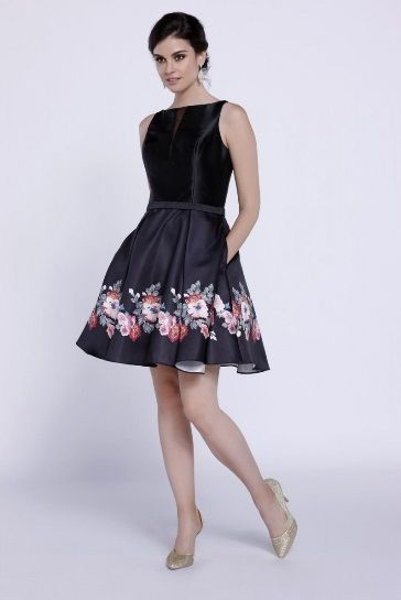 A homecoming dress that you continue to wear for many other occasions like  a date night. The floral print at the bottom give it the perfect touch of elegance.