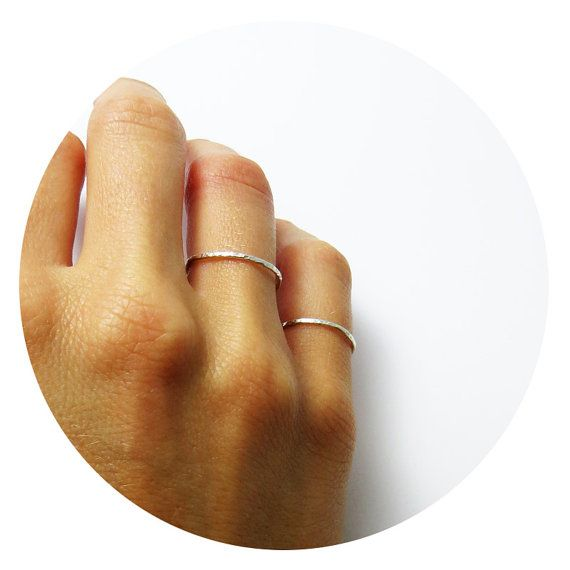 Superfine Thin Hammered Ring in Sterling Silver by Ginny Reynders  Individually handcrafted, using sustainable and safe materials, Ginny Reynders' pieces are dreamt, designed and created in her jewellery studio in Sydney, Australia. Using old-world workmanship, Ginny Reynders personally cuts and crafts precious metals, including 9ct gold and sterling silver, to create her increasingly popular range of everyday, wearable, precious metal jewellery.  Custom-made and Customisable Like all Ginny…