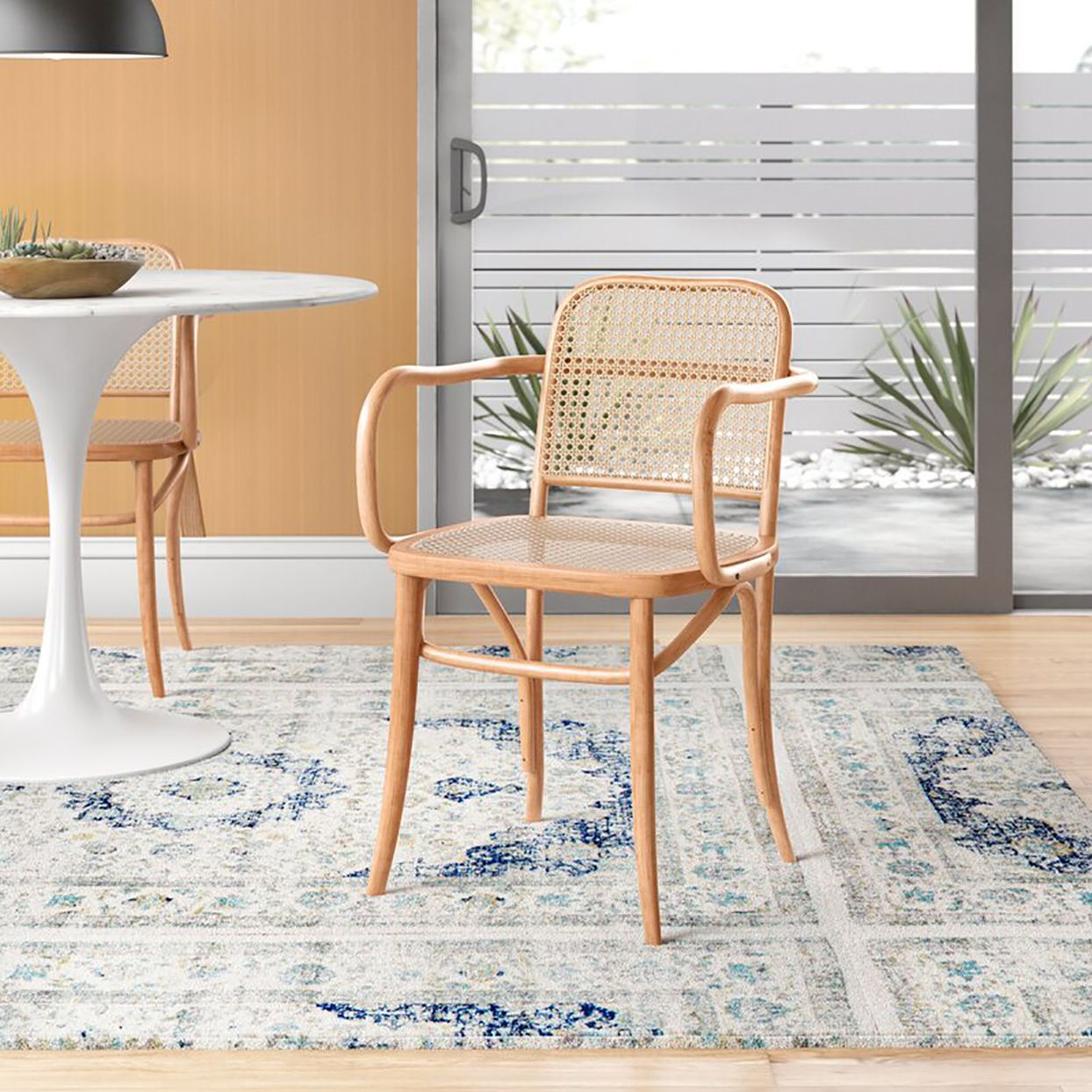 Cane Furniture Is One Of The Hottest Decor Trends This Year Solid Wood Dining Chairs Dining Chairs Cane Dining Chairs