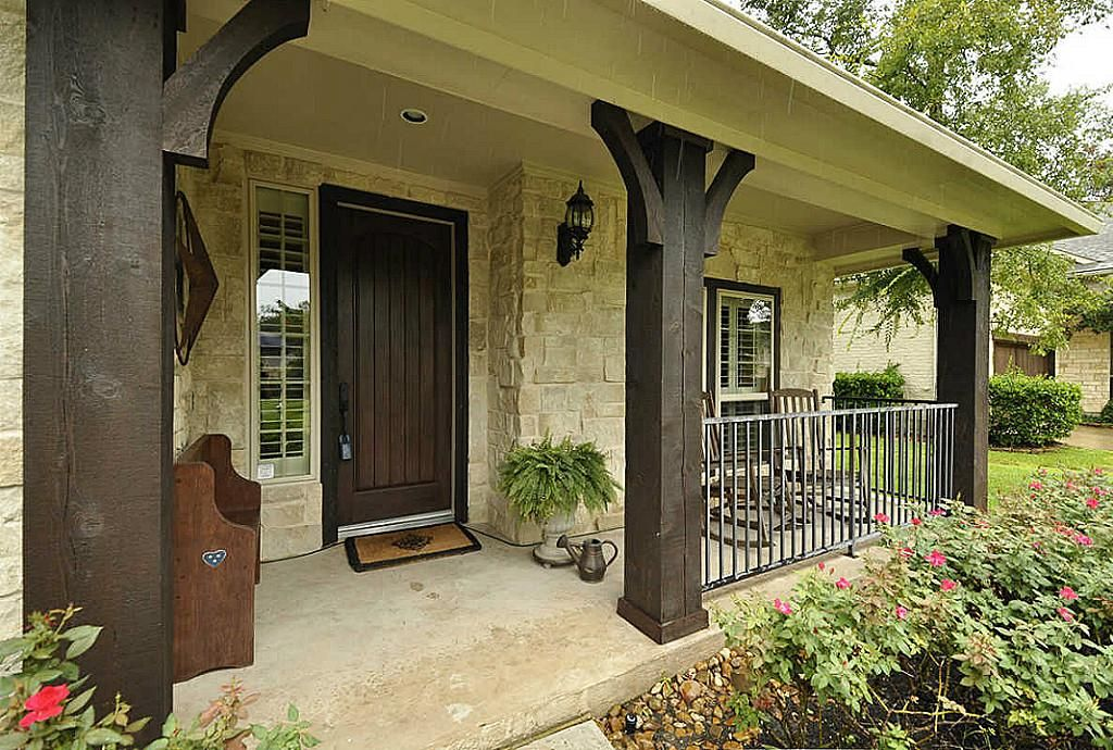 Like the front porch with stone and dark wood just wish for Rustic porch columns