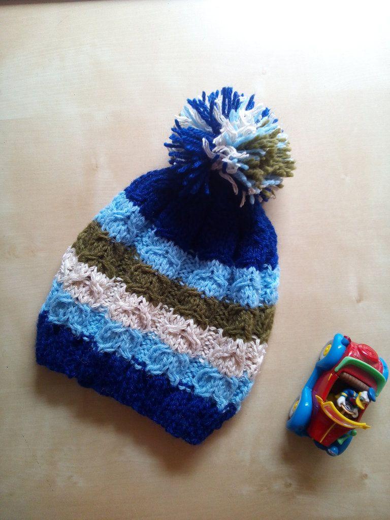 Berretto a trecce bambino fatto a mano ai ferri lana e con pompon - cuffia  lana e30b896e2b63